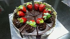 Fresh strawberries and cream in the center covered with dark dense chocolate from Celebrations Fine Confections India Mumbai