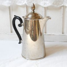 vintage coffee pot, art deco style, silver coffee pot, art deco coffee pot. €16,50, via Etsy.````not art deco..but I like it anyway