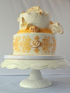 Golden Wedding Anniversary Cake (Best Wedding and Engagement Rings at www.brilliance.com)