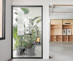 Barcelona-based studio Appareil integrated furniture into the walls to open up this creative co-working space, designed for architects and designers. Coworking Space, Floating Table, Startup Office, Exposed Rafters, Floor Layout, Shop House Plans, Co Working, Design Blog, Shop Interior Design