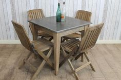 """Introducing our fantastic stone top cafe table. We now stock a range of blue stone restaurant tables with reclaimed pine bases. All of the stone tops are made of 1"""" thick blue stone which is extremely hard wearing; ideal for restaurant or café use. The tops can also be easily cleaned. - See more at: http://www.peppermillantiques.com/stone-top-cafe-table/#sthash.x0Ukqdfm.dpuf"""