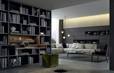 """Wall System in spessart oak. Inner grids th. 1/2"""" piombo mat lacquered. Equipped inserts in spessart oak and Slim fl ap doors visone mat lacquered. Ego Day sides and doors in reflecting transparent glass, carbone mat lacquered frame. Paris-Seoul sofa with pouf end unit, removable covering in 99 ecrù Merida fabric, cushions in 2006 prugna Persia velvet. Paris-Seoul coffee table in black hide, inner side piombo painted."""