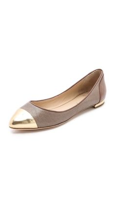 I have a pair of pointed-toe flats this color. Maybe adding a gold toe & heel could be an interesting DIY project?