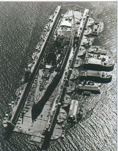 US New Mexico-class battleship in floating dry dock World War II Pacific.
