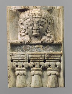 Plaque with woman at the window motif [Neo-Assyrian period; Phoenician style] (57.80.12) | Heilbrunn Timeline of Art History | The Metropolitan Museum of Art
