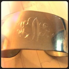 """KLD"" engraved cuff bracelet I received this personalized cuff as a gift, but I never use it. Know anyone with the initials ""KLD?"" Some scuffing, but still very shiny, reflected in price. Price is firm, no trades. Bundle and save! Jewelry Bracelets"