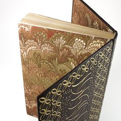 Collected Poems by T.S. Eliot. A full leather fine binding by Mia Leijonstedt in dark brown goat skin, with sewn silk headbands, solid-gilt edges & gold tooling across the covers, both in 24 carat gold leaf. Endpapers & doublures are marbled paper. The back cover also includes the book owner's initials, made to blend in with the style of the rest of the design. 2011.