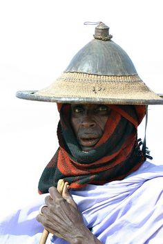 Pulaaku, the Fulani way : The Harmeji Jeedhidhi's 7th Commandment:  Wata firtu aadi means 'always keep your word, respect your word'. Fulbe elder herdsman, with traditional conical straw hat, like the ancient Greek ,Mali.