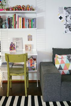 String pocket shelf, Russian nesting dolls and very cute geometric pillows!
