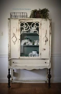 """Vintage Cabinet finished in Old Barn Milk Paint in Sweet Cream. Inside is finished in Annie Sloan Duck Egg. One center door and one dovetail drawer below. Glass knobs are by Wisdom Stone Hardware. Original Skelton key which locks cabinet. Measures 65""""h x 16""""d x 40""""w. Sf Home."""