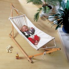 Baby hammock!  Another advantage is, it might encourage them to sleep on side or back, not on the face, for avoiding SIDS issues.
