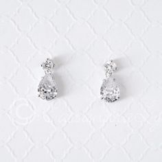 Simple and elegant teardrop CZ earrings. Post back, .75 inches long and 3/8 of an inch wide..