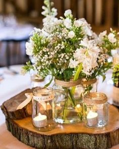 How #gorgeous are these table centrepieces!  Perfect for a #rustic wedding…