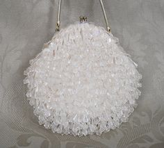 Stunning Wedding Bag is covered in White Iridescent Sequence and Clear Beads, a Snap Closure and approx 10 inch Vermeil Gold Snake Chain!