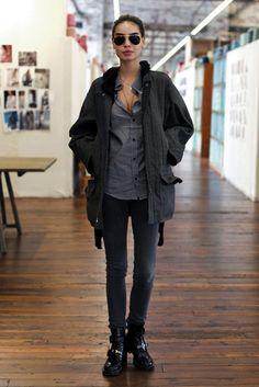 FP model Sabrina Nait off duty; black denim, black shoes, gray button-up, jacket