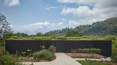 Czech architecture studio Formafatal has used blackened wood, perforated aluminium panels and a green roof to form this low-lying holiday home in Costa Rica. Costa Rica, Timber Cladding, Exterior Cladding, Villas, Round Light Bulbs, Concrete Cover, Law Of The Jungle, Ipe Wood, Charred Wood