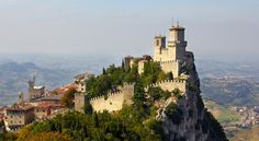 Fortress of Guaita, San Marino. The Guaita fortress is the oldest of the three towers constructed on Monte Titano, and the most famous. It was built in the 11th century and served briefly as a prison. It is one of the three towers depicted on both the national flag and coat of arms.