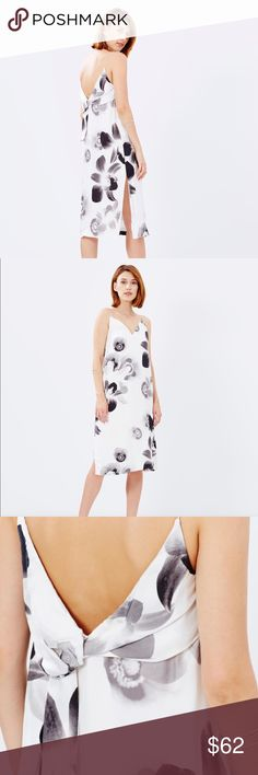 Talulah Supersitition Shift Dress black and white New Talulah Superstition Shift Midi Dress falls relaxed around the body forming a modern shift silhouette.  monochrome blooms which lend the piece a soft femininity. This is a size small dress.  Length: 112cm, the model is tall in this pic so if your a 5'3 and under it can almost be like a maxi dress. Relaxed fit, Matte satin; fully lined. Digital floral print - V-neckline; spaghetti shoulder straps - Gathered tie embellishment on the back…