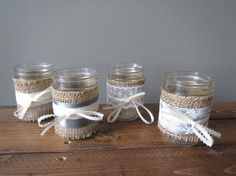 Mason jar candle holders wrapped with rustic burlap, lace, and ribbon - the perfect touch for that barn or country wedding, candlelight is so cozy and romantic! Mason Jar Candle Holders, Mason Jars, Burlap Lace, The Perfect Touch, Rustic Feel, Ribbon Colors, Dinner Table, Rustic Wedding, Wedding Decorations