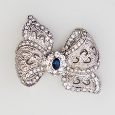 Chic Bow Shape Pin with Crystal and Blue Stones.