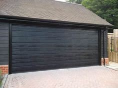 3 - Insulated Sectional Garage Door fully finished in Black fitted in Ascot, Berkshire. We fitted the Door with the Carteck Electric Door opener for ease of use. Black Windows Exterior, Upvc French Doors, Electric Garage Doors, Sectional Garage Doors, Roller Doors, Door Opener, Ascot, Home Improvement, Car