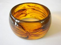 Check out this item in my Etsy shop https://www.etsy.com/listing/501507151/wide-chunky-vintage-amber-lucite-bangle