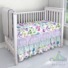 Crib bedding in Lilac Osborne Damask, Icy Mint Lattice, Bright Wildflower. Created using the Nursery Designer® by Carousel Designs where you mix and match from hundreds of fabrics to create your own unique baby bedding. #carouseldesigns