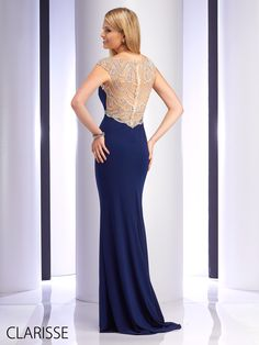 Sexy and Sultry Navy Blue 2016 Clarisse Prom Dress Style 2729. Features high neckline with silver beaded cap sleeves, silver beaded belt, and sparkly silver beaded illusion back. Available in sizes 0-20.