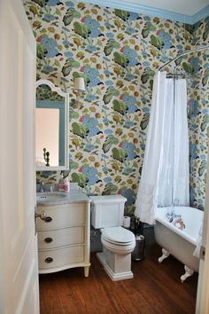 Love the impact of a fun wallpaper in a small bathroom. Boom! Design by Bailey McCarthy of Biscuit Home. #inspiredbylife