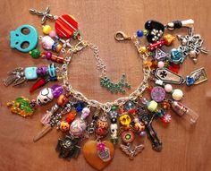 Amanda Olivo Day of the Dead ooak Charm Bracelet - MEXICAN FOLK ART Loaded Skulls Vial pendant.  via Etsy......AWESOME!