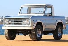 """This 1968 Ford Bronco is a cool half-cab model with a non-factory but well-chosen 351W mated to what's likely to be the original 3-speed manual gearbox. The truck itself looks nice inside, out and underneath, with a mild 3"""" lift, flares, and big rolling stock on top, and power steering and"""