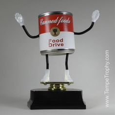 Canned Food Drive Trophy (www.TempeTrophy.com) #TempeTrophy Food Bank, A Food, Pumpkin Jokes, Canned Food Drive, Souper Bowl, Food Shelf, Food Sculpture, Merit Badge, Student Council