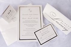 very elegant invitation with metallic silver and white. All the day off items is matching