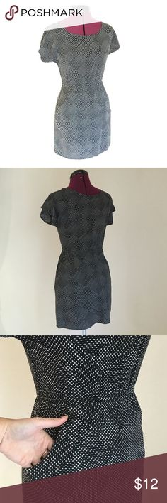 XHILARATION easy summer dress with POCKETS Black and white geometric print dress with short sleeves, elastic cinched waist and POCKETS! Wear for a casual lunch or easily dress it up a bit with wedges and cute jewelry! Xhilaration Dresses Mini