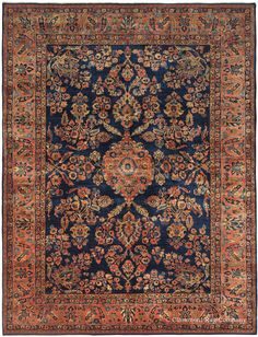 In virtually unblemished condition with a lustrous, light-reflecting full pile, this Mahajiran Sarouk vintage Persian carpet is a showcase of inspired early 20th century Oriental rug weaving.