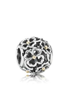 Pandora's understated floral charm features sterling silver blooms with 14k gold accents, making it a simply elegant addition to your everyday charm mix. | Sterling silver/14k gold | Imported | Style