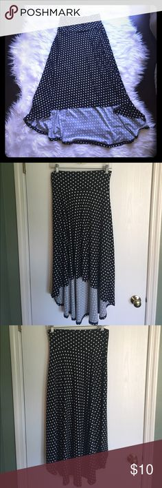 Black and white polka dot skirt Black and white polka dot skirt. High/low style. Medium. Polyester/spandex. Great condition Skirts High Low
