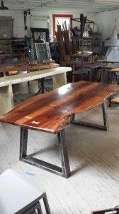 """Stunning """"book-matched"""" Australian Pine slab top with inlaid Oak butterfly joints. Sits on top of contemporary steel base. 84″ x 40″ Truly one of a kind!!!"""