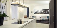 bultaup b3 matlak alpine white units with white corian tops dark wood appliance wall with limestone floor and kevin reilly light