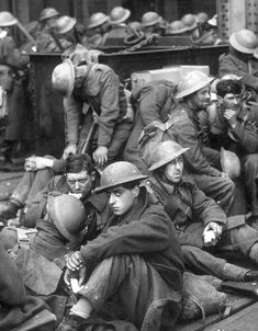 Dunkirk, 1940. Exhausted British soldiers await evacuation. (Regiment to be identified).