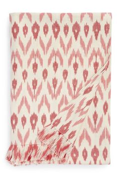 The perfect throw for a picnic on the beach. Love the red arrow print.