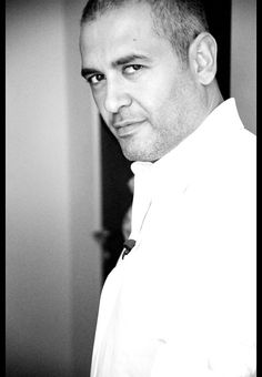 elie saab, lebanese fashion designer, born: july 4th 1964, lives in switzerland with wife claudine & three sons