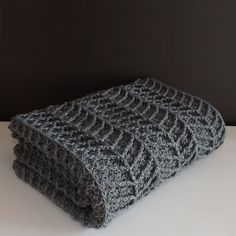 With clean lines and a thick cozy feel this modern crochet blanket would make a great addition to any home Find the #crochet #pattern on Etsy Craftsy or Ravelry today!! by lakesideloops