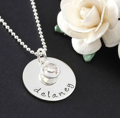 The single name pendant is a beautiful sterling silver 3/4 round disc with your choice of name or word and birthstone.