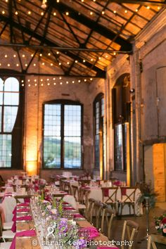 Rustic Elegance at Summer wedding at Basilica Hudson in NY with pink and navy by ©️ Sarah Tew Photography seen at: http://www.sarahtewphotography.com/blog/rustic-industrial-wedding-at-basilica-hudson/   featuring Hudson Valley Vintage Rentals, Steven Bruce Design, Main Course Catering, Monique Lhuillier, Eric Nicolas & One Love