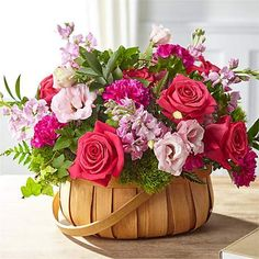 Inspired by bright shades and soft textures, this arrangement will wow your loved ones with its mix of roses, carnations, and lisianthus in a woven basket. Beautiful Flower Arrangements, Floral Arrangements, Beautiful Flowers, Valentine Flower Arrangements, Basket Flower Arrangements, Thanksgiving Flowers, Christmas Plants, Pink Plant, Sympathy Flowers