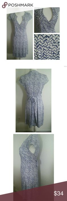 THE LIMITED WRAP DRESS Like new. Only worn once. In great condition. No stains. No tears. Polyester and spandex. Perfect for summer. The Limited Dresses