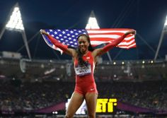 Sanya Richards Ross from the U.S. holds her national flag and celebrates after winning the women's 400-meter final during the athletics competition in the Olympic Stadium at the 2012 Summer Olympics.