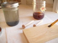 Tea and Ironed Vinegar wood staining technique. Basically, soak fine steel wool in white vinegar for 24 hours. Stain the wood first with tea, and second with the vinegar, but only after each coat/layer has dried completely!