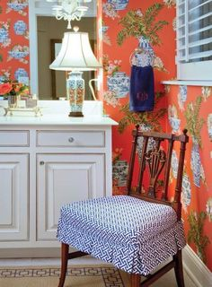 Give a small powder room a pop of color using a fun combination of cobalt and tangerine.